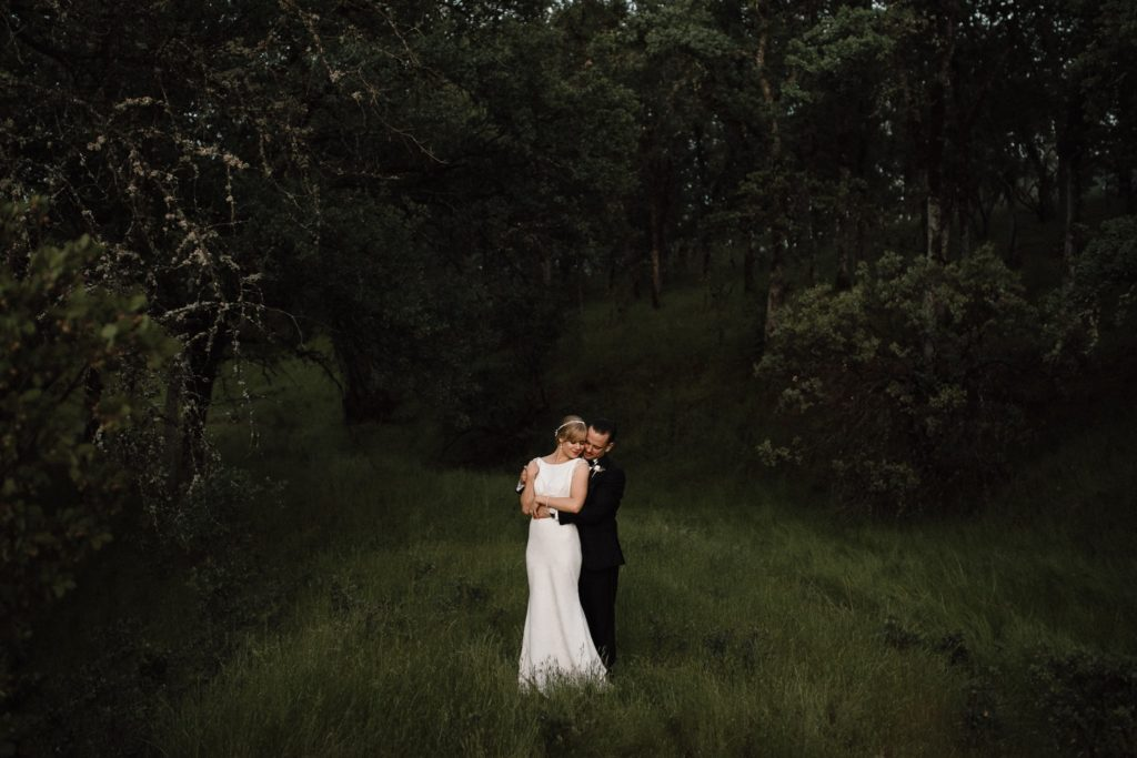 Bride and Groom hug at TBS Ranch