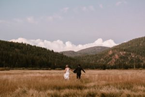 Bride and Groom run through a meadow in Squaw Valley near Lake Tahoe