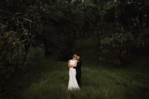Bride and Groom hug at TBS Ranch