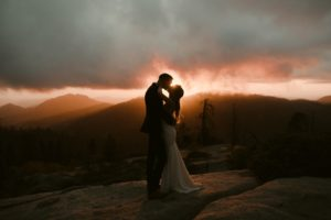 Bride and Groom kiss over amazing sunset in the Sequoia National Park