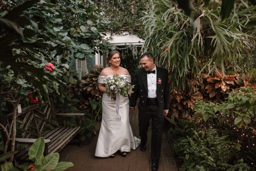Bride and Groom exits joyously exits ceremony at Lamberton Conservatory.