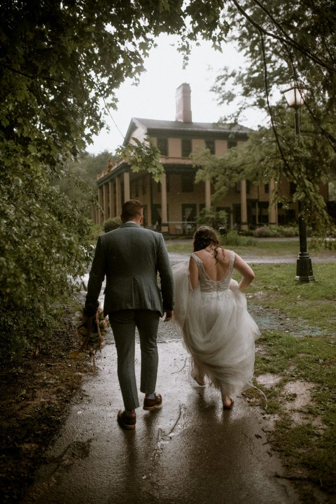 Married couple walks back to the Glen Iris Inn in the rain.