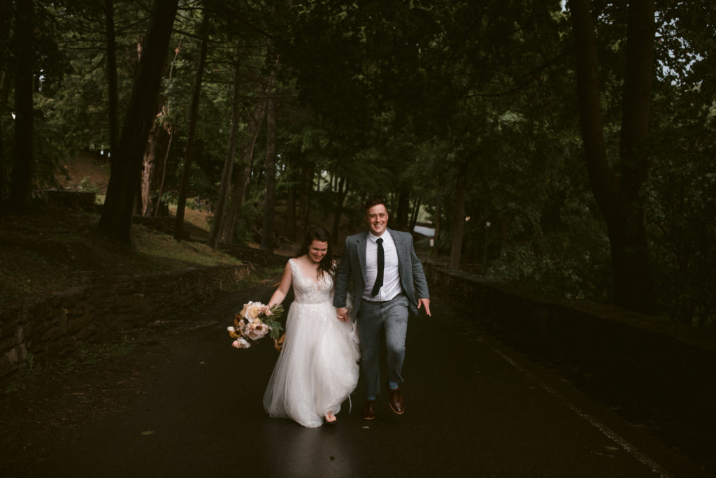 Bride and Groom run along Park Road in Letchworth.