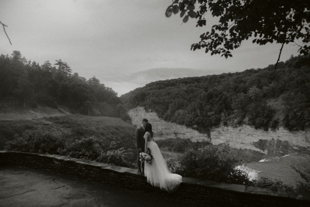 Couple kisses above Middle Falls.