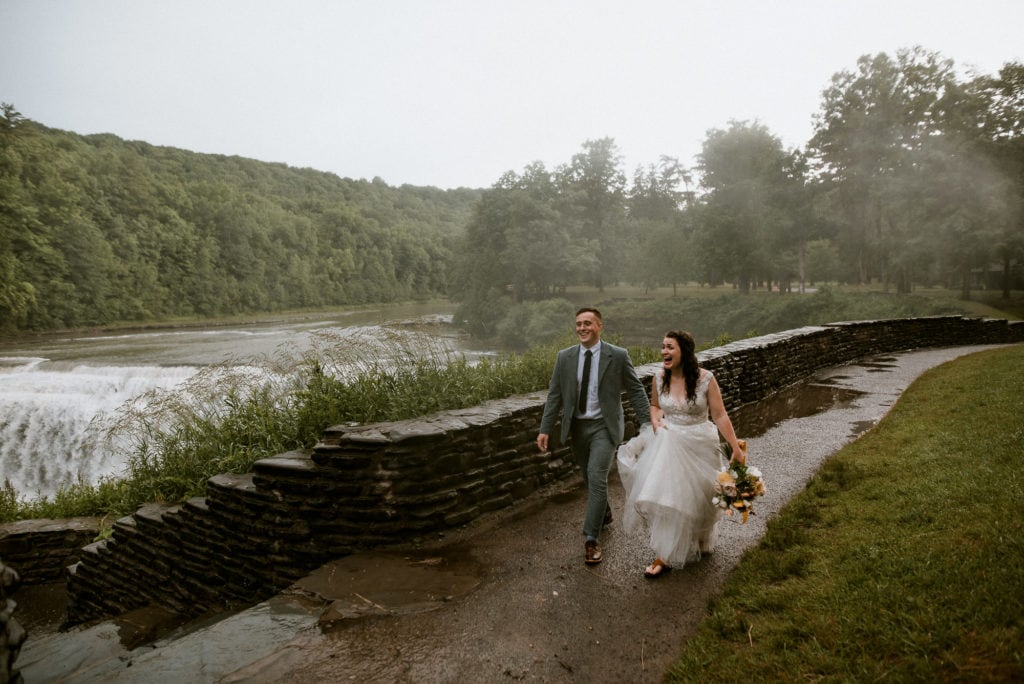 Groom and Bride walk along Middle Falls trail.
